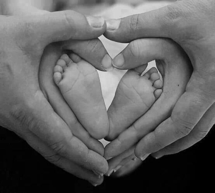 Family hands and baby feet